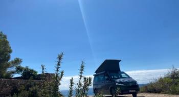 camper under blue sky