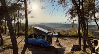 van over a mountain with girl on a chair