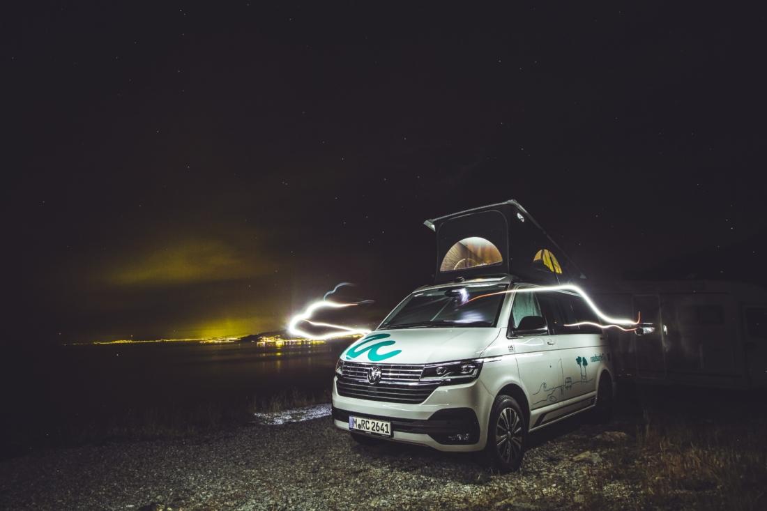 camper at beach at night