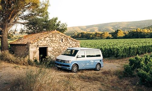 roadsurfer van parking at a farm