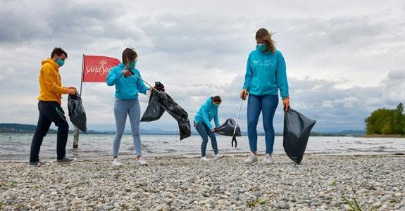 roadsurfer team collects trash