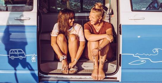 girls sitting in a campervan