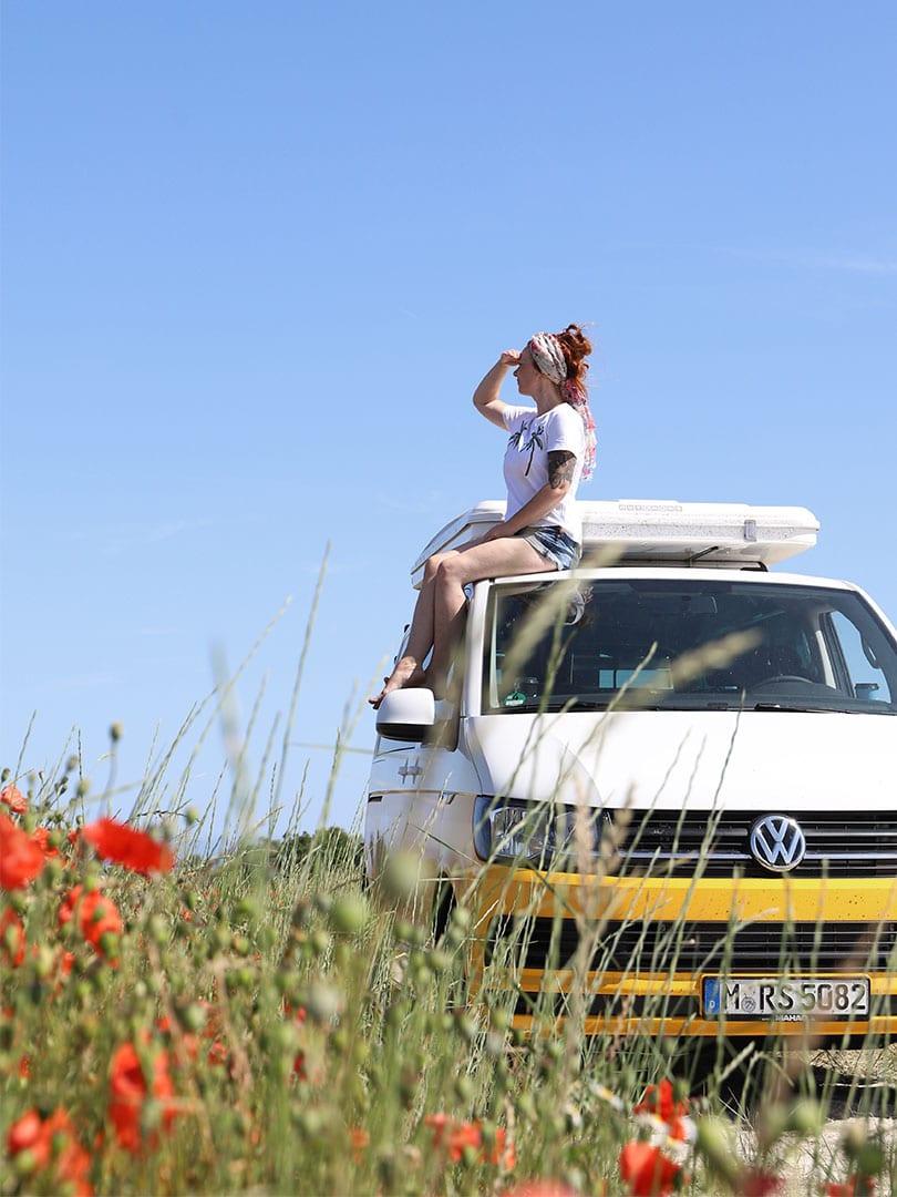 Girl sitting on a campervan